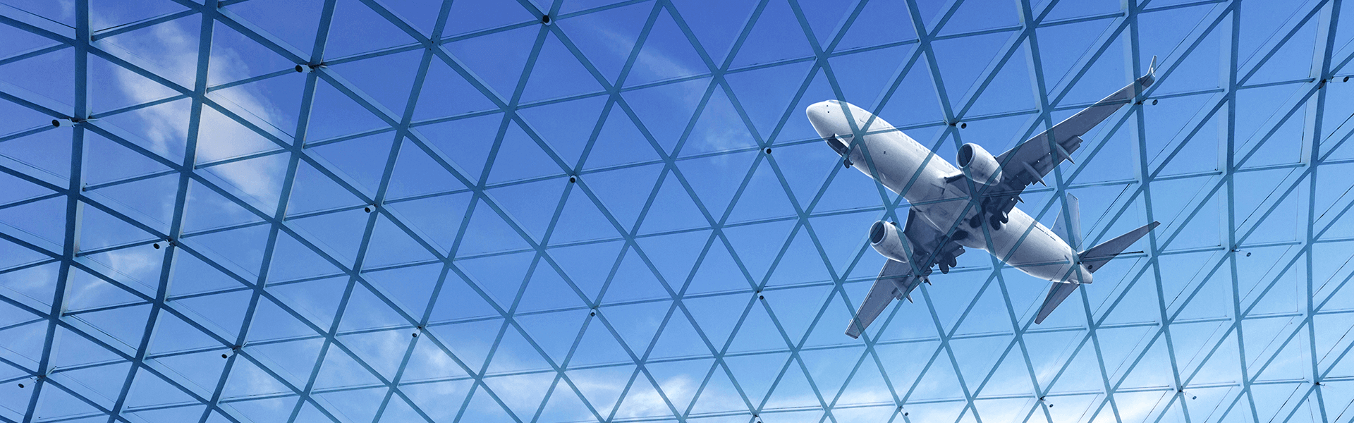 Plane flying above a glass ceiling